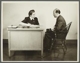 Health Examination-Men Album -- Nurse Questioning Man in Office