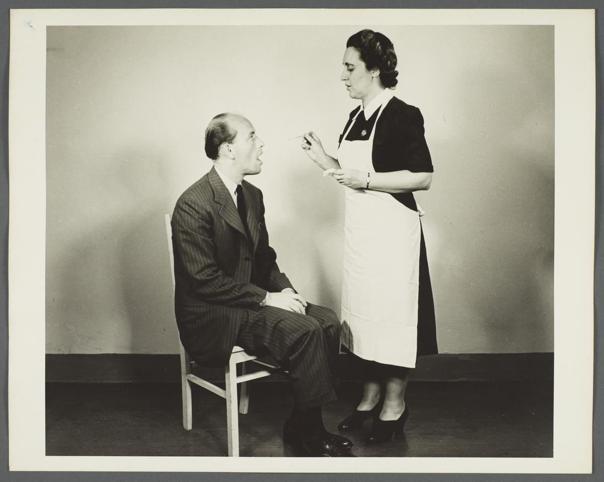 Health Examination-Men Album -- Nurse Taking Man's Temperature