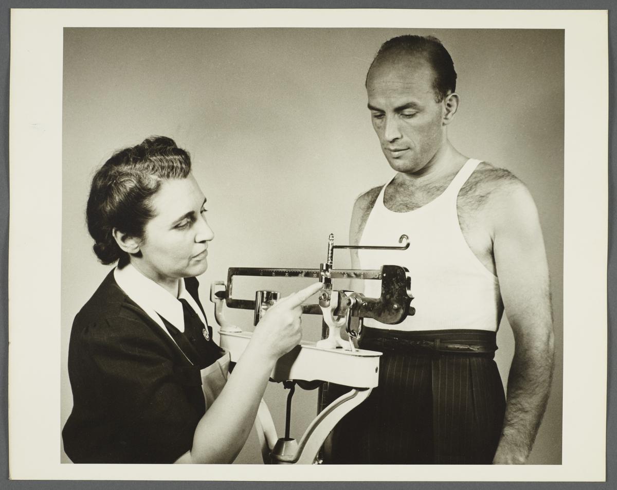 Health Examination-Men Album -- Nurse Weighing Man