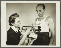 Health Examination-Men Album -- Nurse Weighing Man