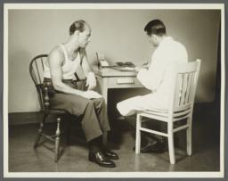 Health Examination-Men Album -- Doctor Taking Man's Medical History