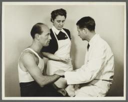 Health Examination-Men Album -- Doctor with Nurse Checking Man's Pulse