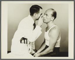 Health Examination-Men Album -- Doctor Examining Man's Eyes