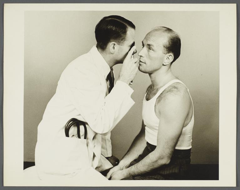 Health Examination-Men Album -- Doctor Examining Man's Eyes