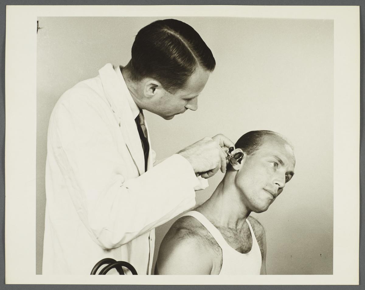 Health Examination-Men Album -- Doctor Examining Man's Ears