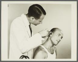 Health Examination-Men Album -- Doctor Examining Man's Ears