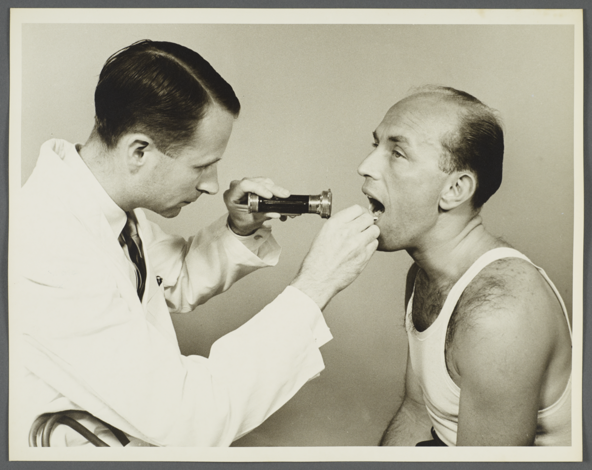 Health Examination-Men Album -- Doctor Examining Man's Mouth