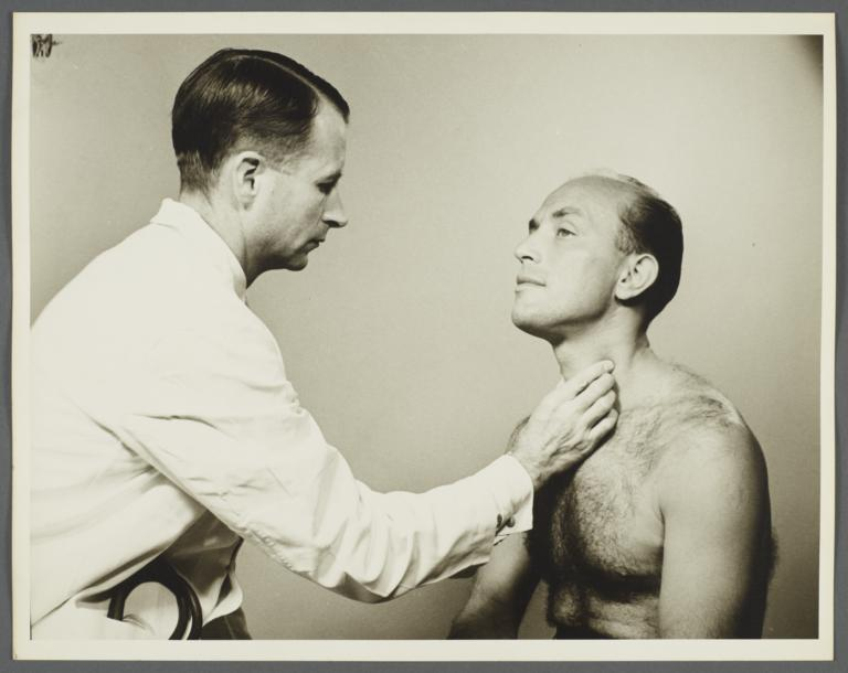 Health Examination-Men Album -- Doctor Examining Man's Thyroid