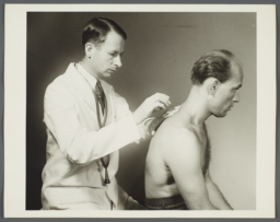 Health Examination-Men Album -- Doctor Checking Man's Lungs