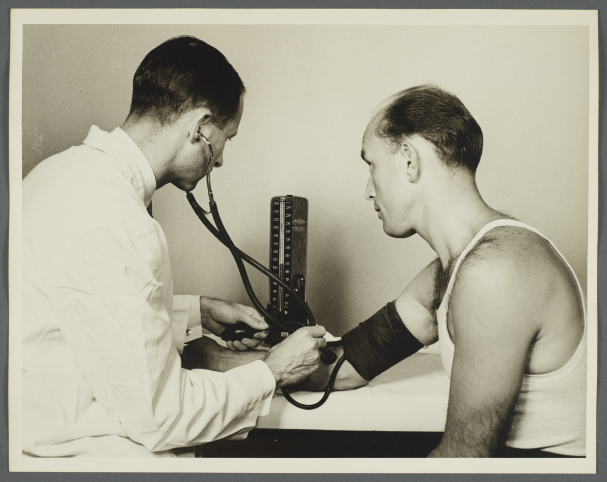 Health Examination-Men Album -- Doctor Taking Man's Blood Pressure