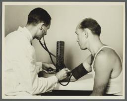 Health Examination-Men Album -- Doctor Taking Man's Blood Pressure
