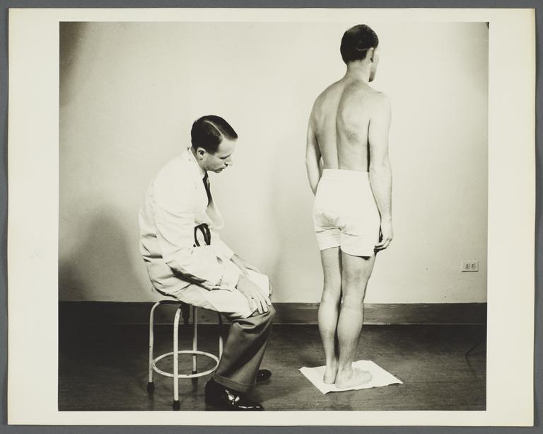 Health Examination-Men Album -- Doctor Checking Man's Posture