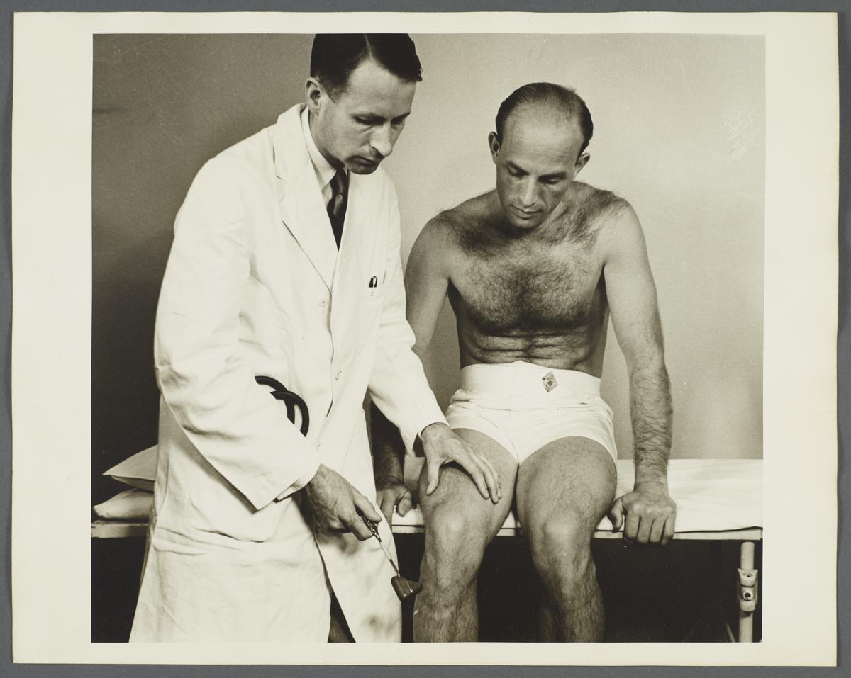 Health Examination-Men Album -- Doctor Checking Man's Reflexes