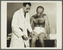 Health Examination-Men Album -- Doctor Checking Man's Reflexes