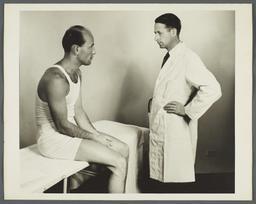 Health Examination-Men Album -- Man on Exam Table with Doctor