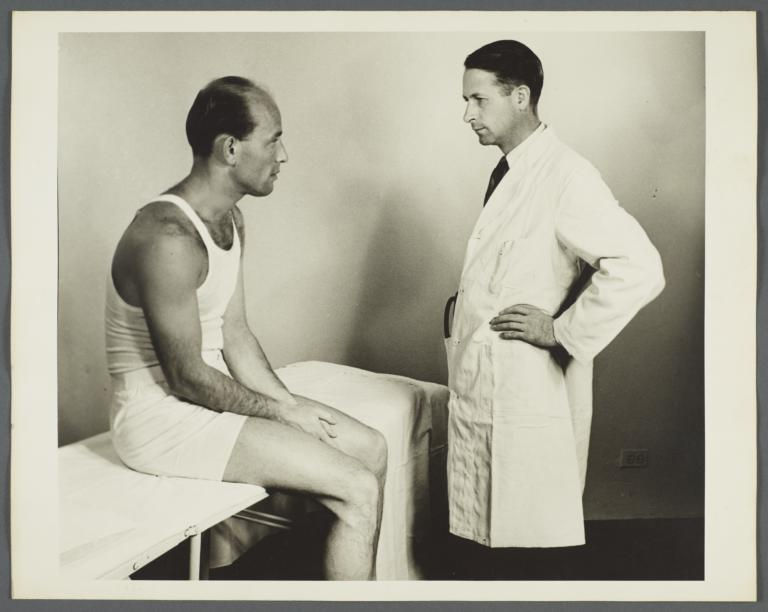 Health Examination-Men Album -- Man on Exam Table with Doctor
