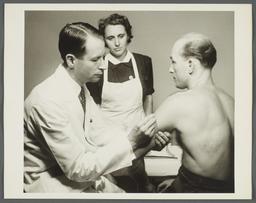 Health Examination-Men Album -- Doctor with Nurse Administering Immunization