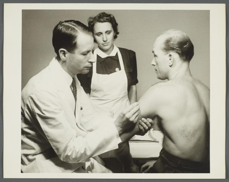 Health Examination-Men Album -- Doctor with Nurse Administering Immunization