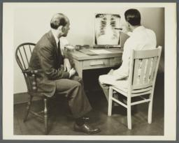 Health Examination-Men Album -- Doctor Discussing Chest X-ray with Man
