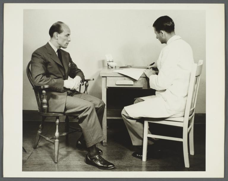 Health Examination-Men Album -- Doctor Speaking with Man in Office