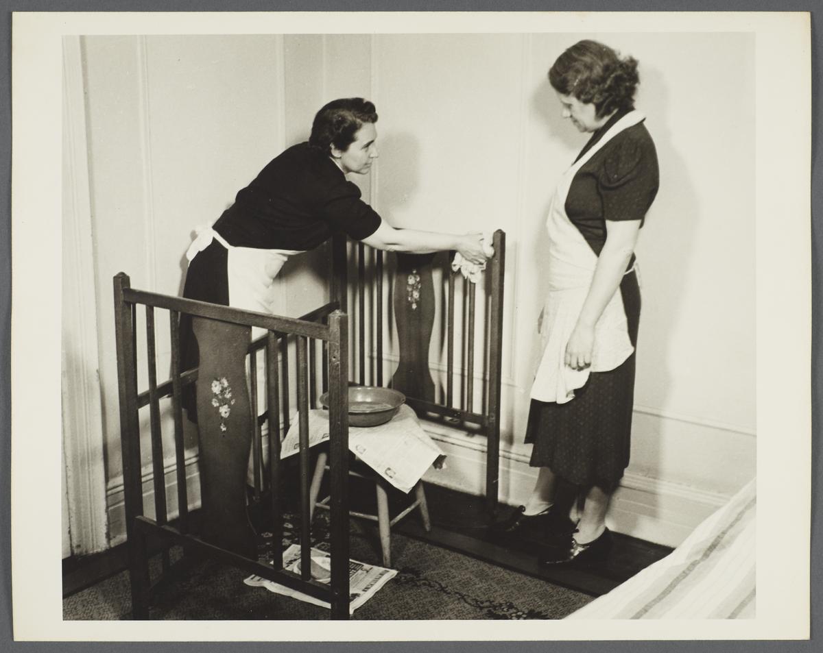 Nurses' Family Health Series: Tuberculosis Album -- Nurse Cleaning Crib