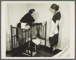 Nurses' Family Health Series: Tuberculosis Album -- Nurse Cleaning Crib