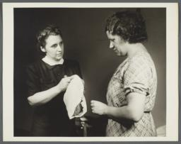 Nurses' Family Health Series: Tuberculosis Album -- Nurse Shows Mrs. Balton How to Clean Floors