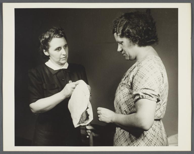 Nurses' Family Health Series: Tuberculosis Album -- Nurse Shows Mrs. Balton How to Clean Floors
