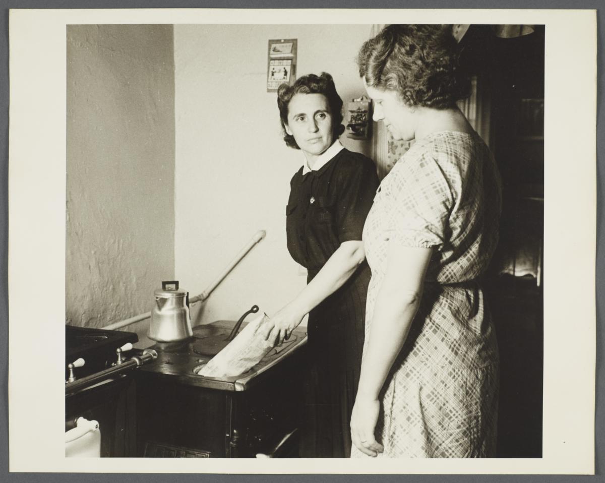 Nurses' Family Health Series: Tuberculosis Album -- Nurse Teaching Mrs. Balton to Dispose of Waste
