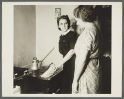 Nurses' Family Health Series: Tuberculosis Album -- Nurse Teaching Mrs. Balton to Dispose of Waste