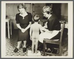 Nurses' Family Health Series: Tuberculosis Album -- Nurse Inspecting Boy