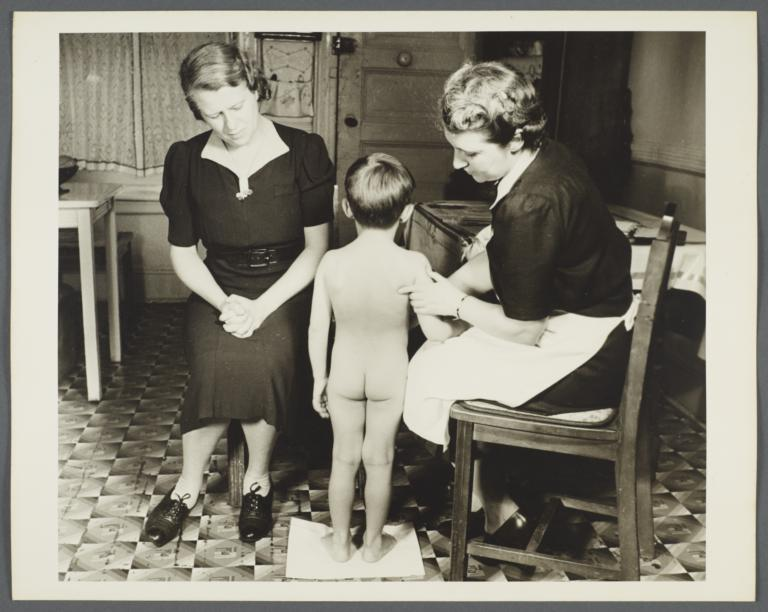 Nurses' Family Health Series: Tuberculosis Album -- Nurse Inspecting Boy