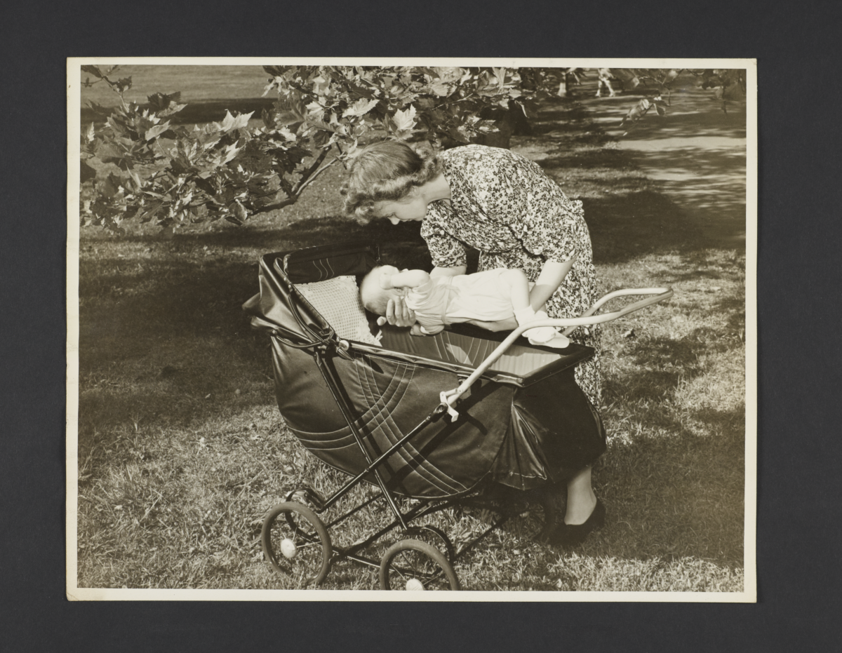 Picturing Some of the Principles of Child Care Album -- Mother Placing Baby in Carriage