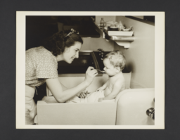 Picturing Some of the Principles of Child Care Album -- Woman Feeding Baby