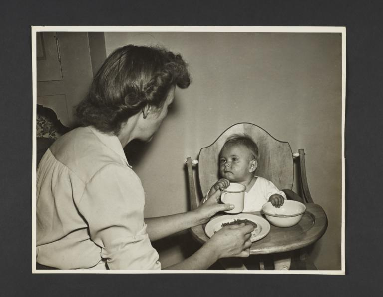 Picturing Some of the Principles of Child Care Album -- Mother Feeding Baby