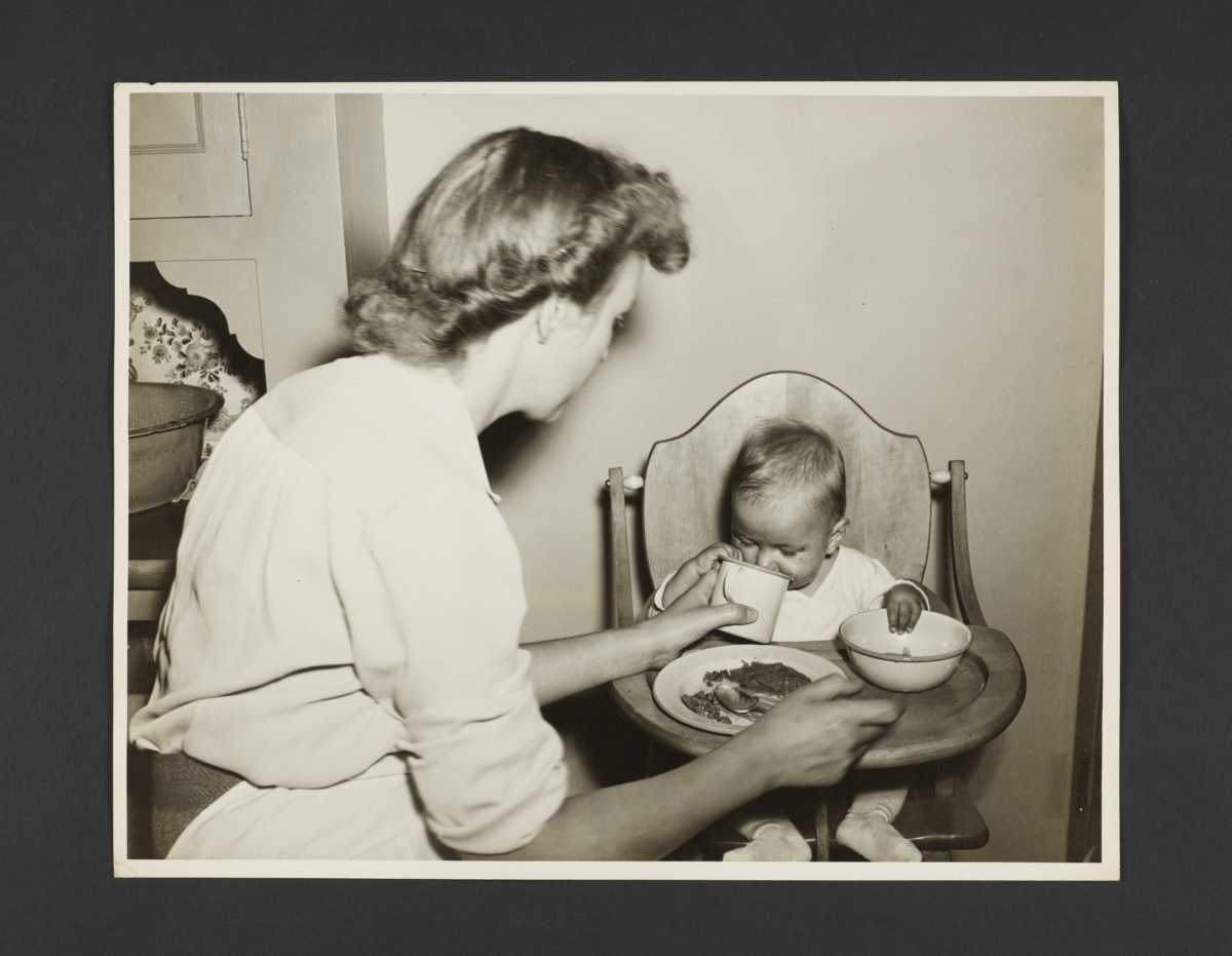 Picturing Some of the Principles of Child Care Album -- Baby Drinking from Cup