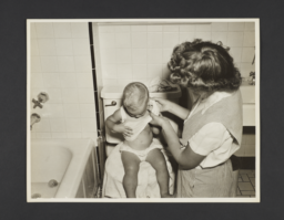 Picturing Some of the Principles of Child Care Album -- Mother Undressing Baby by Tub