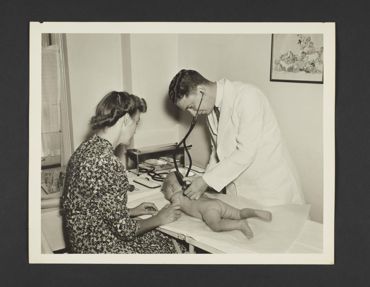 Picturing Some of the Principles of Child Care Album -- Doctor Examines Baby