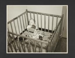 Picturing Some of the Principles of Child Care Album -- Baby in Playpen