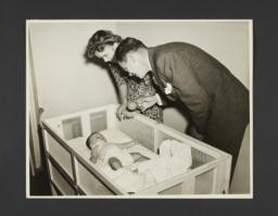 Picturing Some of the Principles of Child Care Album -- Father and Mother Watching Baby