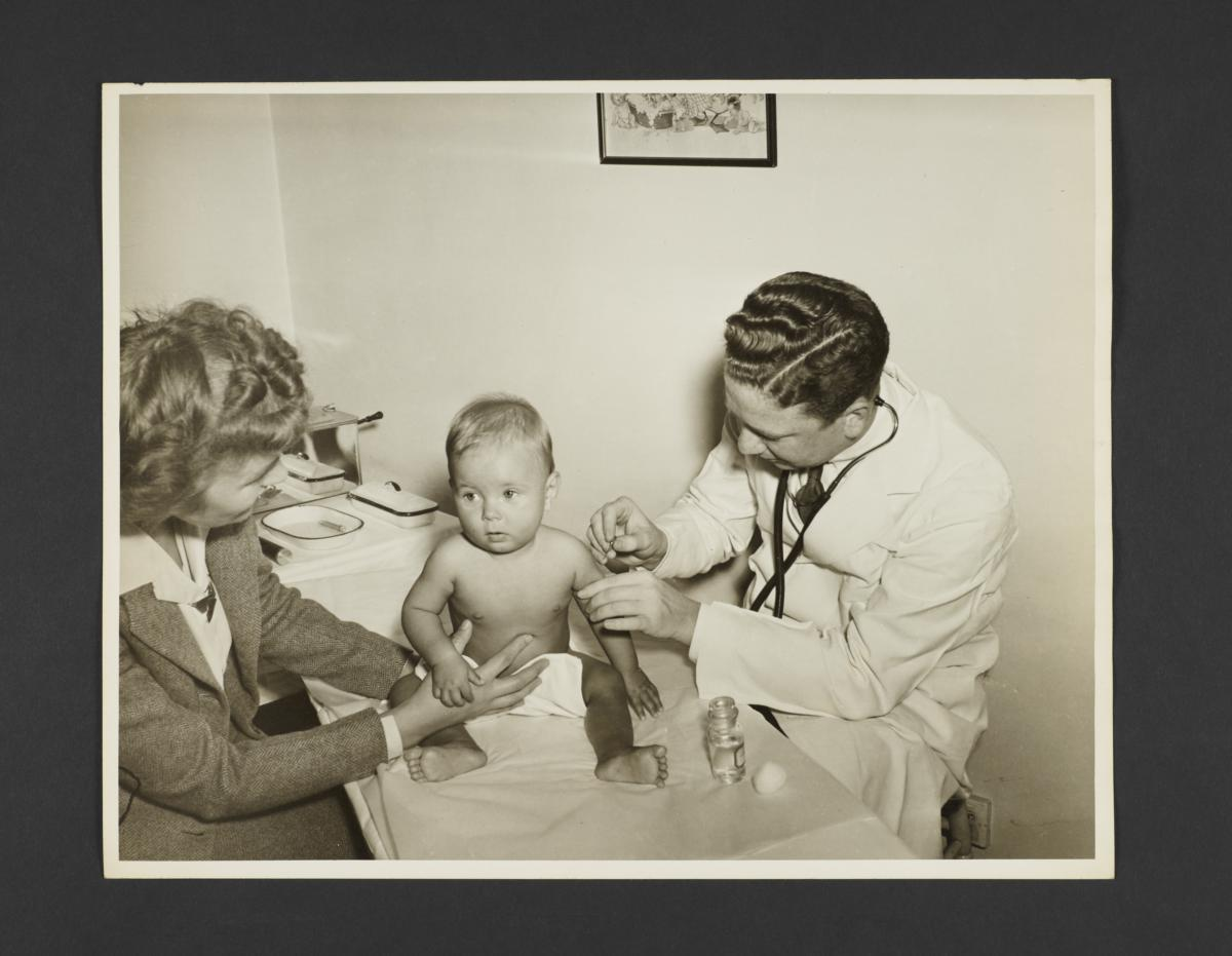 Picturing Some of the Principles of Child Care Album -- Doctor Inoculates Baby