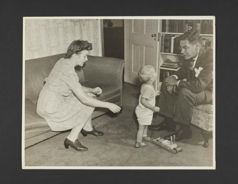 Picturing Some of the Principles of Child Care Album -- Baby Walking from Mother to Father