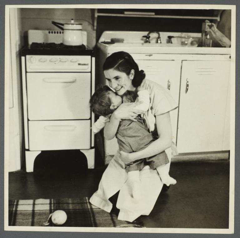 Lenox Hill, 1948-1949 Album -- Woman with Child in Kitchen