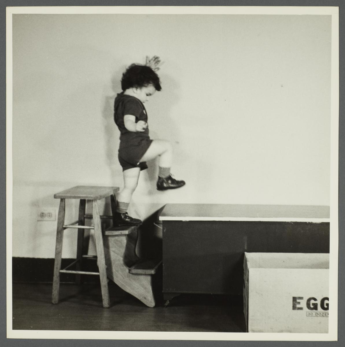 Lenox Hill, 1948-1949 Album -- Boy Stepping from Stool to Table