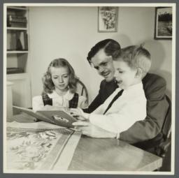 Lenox Hill, 1948-1949 Album -- Man with Two Children Reading Book