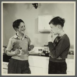 Lenox Hill, 1948-1949 Album -- Two Boys Eating Sandwiches