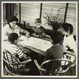 Lenox Hill, 1948-1949 Album -- Woman with Children Playing Bottle Cap Game