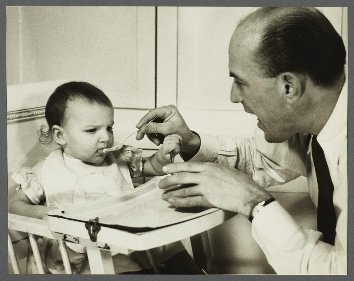 Lenox Hill, 1948-1949 Album -- Man Feeding Baby
