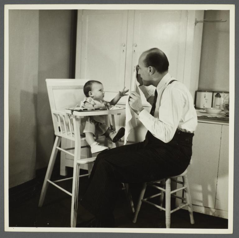 Lenox Hill, 1948-1949 Album -- Man Hiding Behind Napkin for Baby