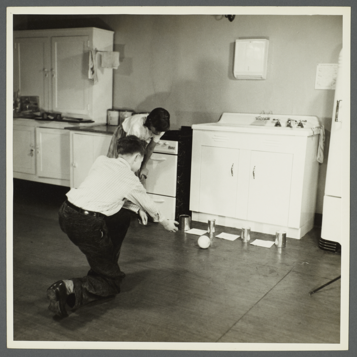 Lenox Hill, 1948-1949 Album -- Playing Game in Kitchen